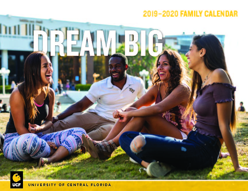 """Students sitting on grass in front of Millican Hall with words """"Dream Big"""" above their heads"""